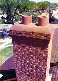 A chimney we rebuilt from the roof of the house back up to its original height. It has a 2 course corbell so water doesn't run down the chimney.