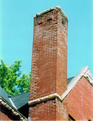 This is a photo from before we repaired the chimney. Most of the mortar joints on the top and corners are empty and some bricks spalling.
