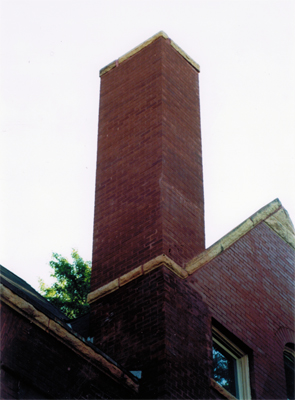 The chimney repair is not noticable as the brick match perfectly with the rest of the building as well as the mortar joints.