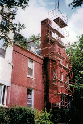 We set up scaffolding from the ground to transport materials and haul down brick from the old chimney.