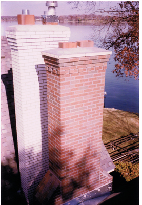 Two chimneys side by side that we rebuilt each of. Each has a corbelled top, meaning the bricks stick out so water doesn't run down the chimney