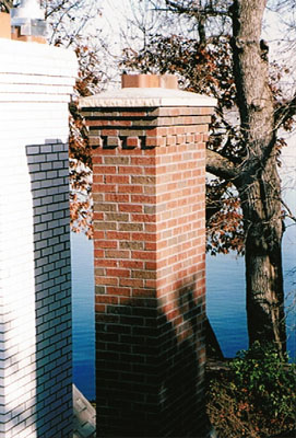 Another view of the chimneys which allows you to see the cement cap that has a gradual slope making all water run down instead of pooling.