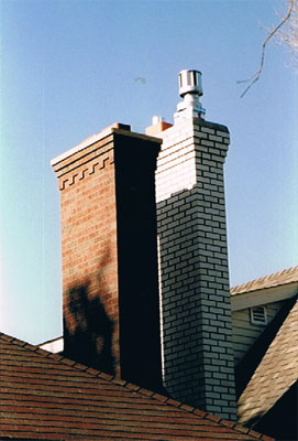 We rebuilt these chimneys that are side by side using new bricks.