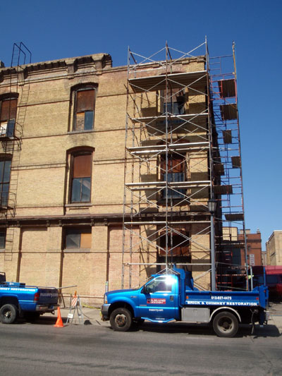 We set up scaffolding downtown to rebuild several arches on a building that had damaged chaska brick.