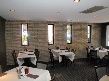 Brick veneer installed in a restaurant in the warehouse district.